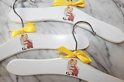Girl with doll hangers make Baby Shower gifts for the